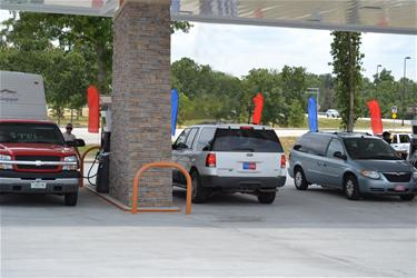 Vehicle Getting Fuel at the Downstream Q Store Gas Station